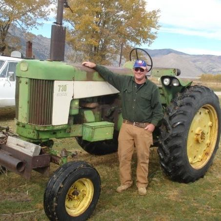 Dad by his tractor